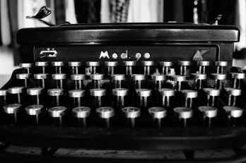 gray scale photography of typewriter